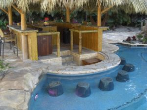Pools side bar with submerged stools