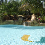 Custom Grottos, Waterfalls and Faux Rock Swimming Pools by Sammet Pools in South Florida covering Dade, Broward & Palm Beach Counties