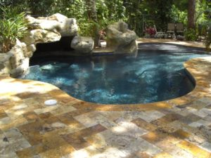 Faux Rock and Deck designed and built by Sammet Pools of South Florida